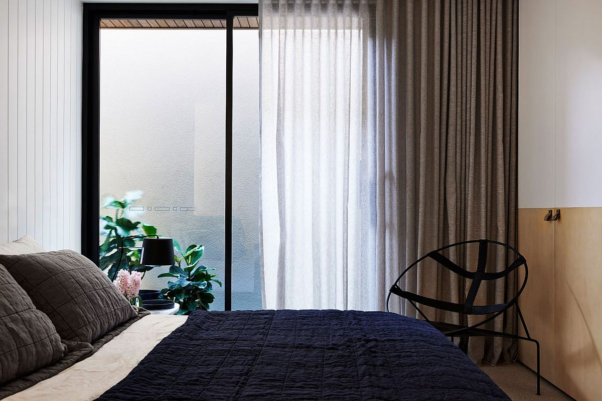 Modern bedroom with a series of drapes and sheers