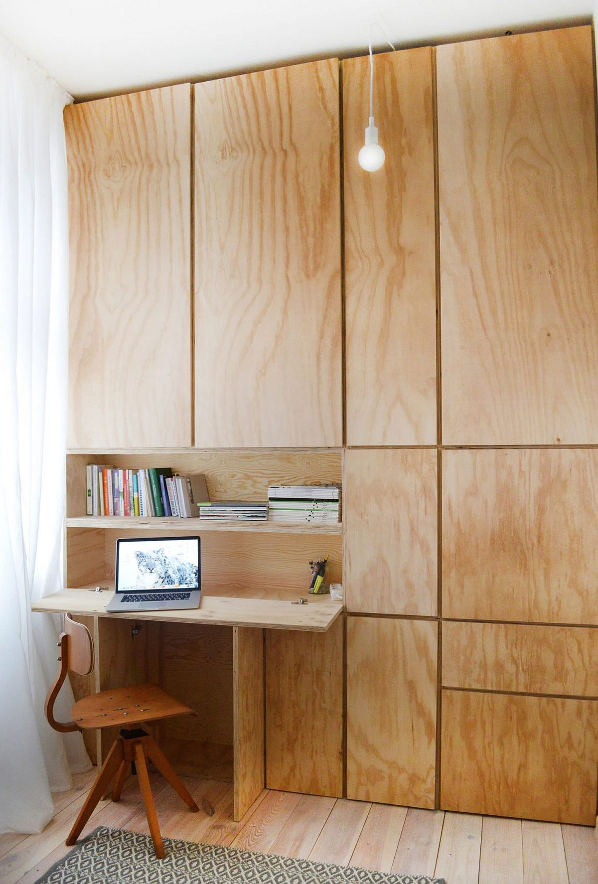 Modern home office with a wall of wood