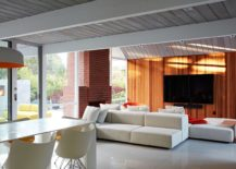 Modern-living-room-with-wood-siding-and-a-breezy-ambiance-217x155