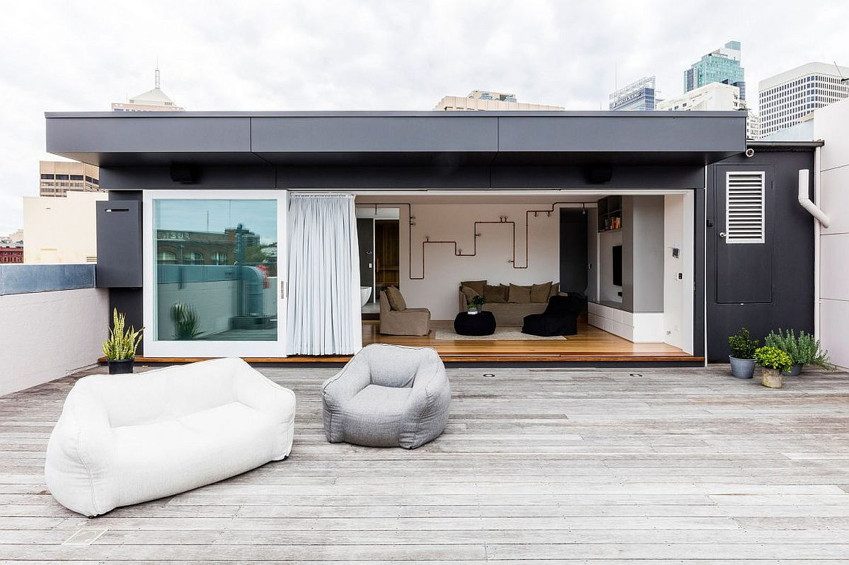 Modern minimal deck of the revamped Aussie apartment