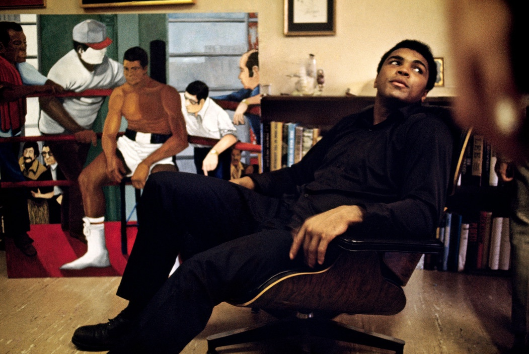 Muhammad Ali at home on his Eames Lounge Chair in 1970. Image © 2016 Eames Office, LLC.USA.
