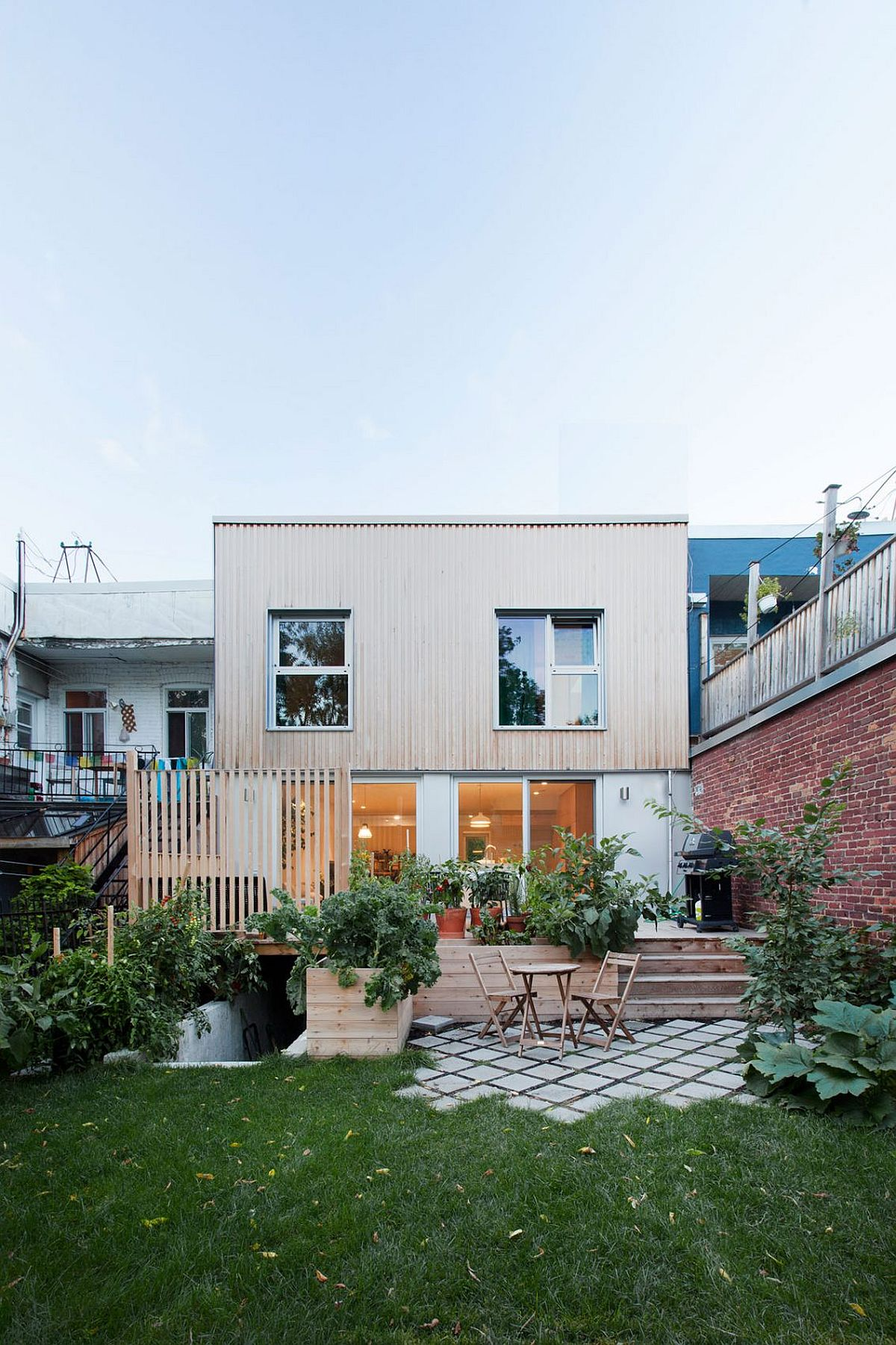 New wooden deck and outdoor living zone of the revamped home in Montreal