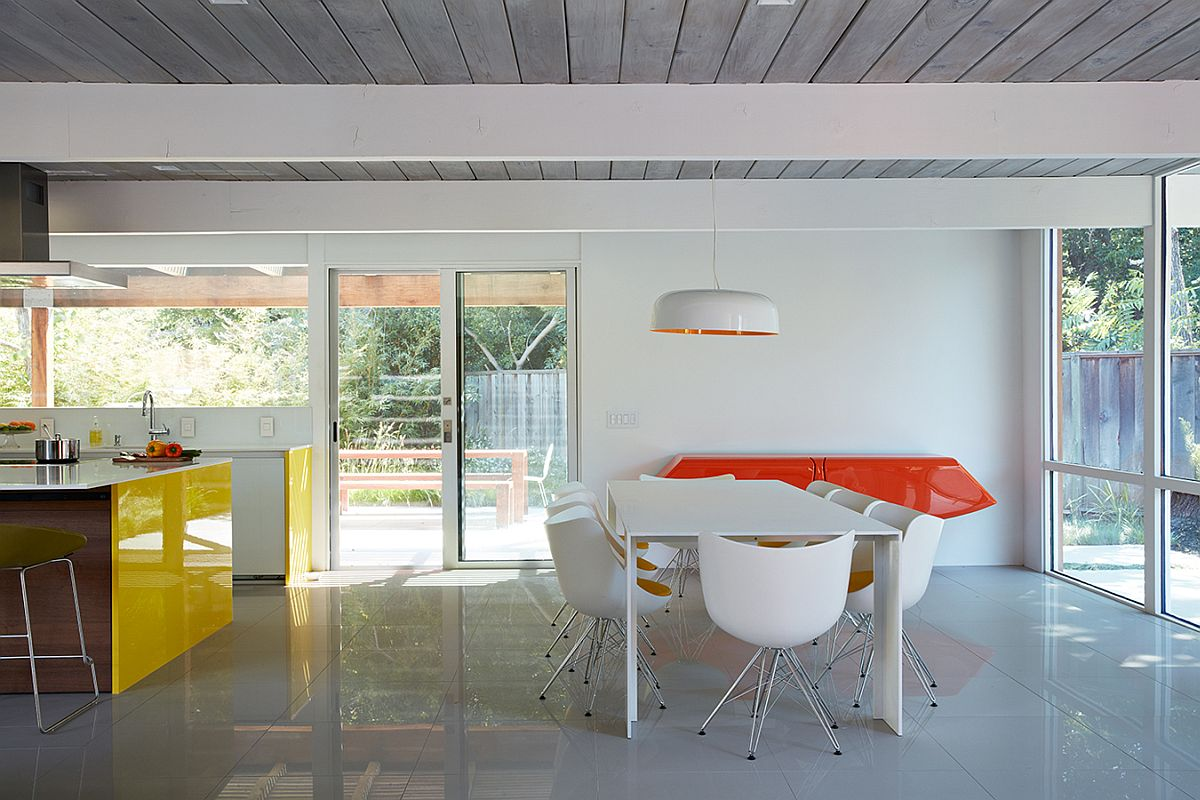 Orange adds zest and contrast to the neutral dining room