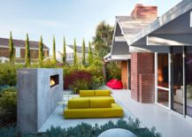 Outdoor-hangout-with-bright-yellow-seating-and-contemporary-fireplace-217x155