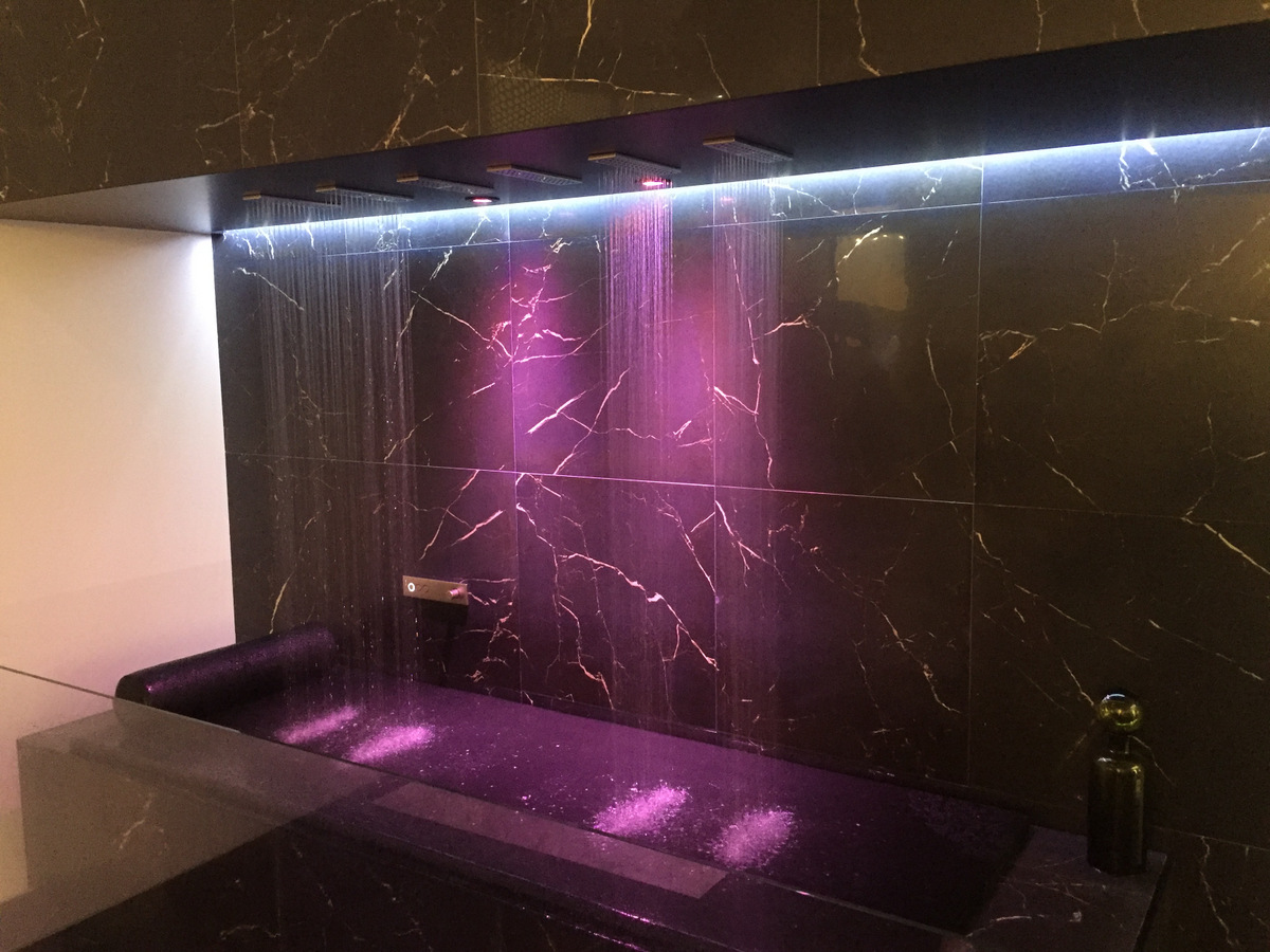 Pink lighting in a modern powder room