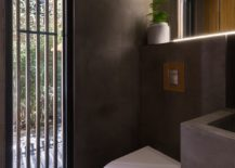 Polished-concrete-shapes-the-contemporary-bathroom-with-garden-view-217x155