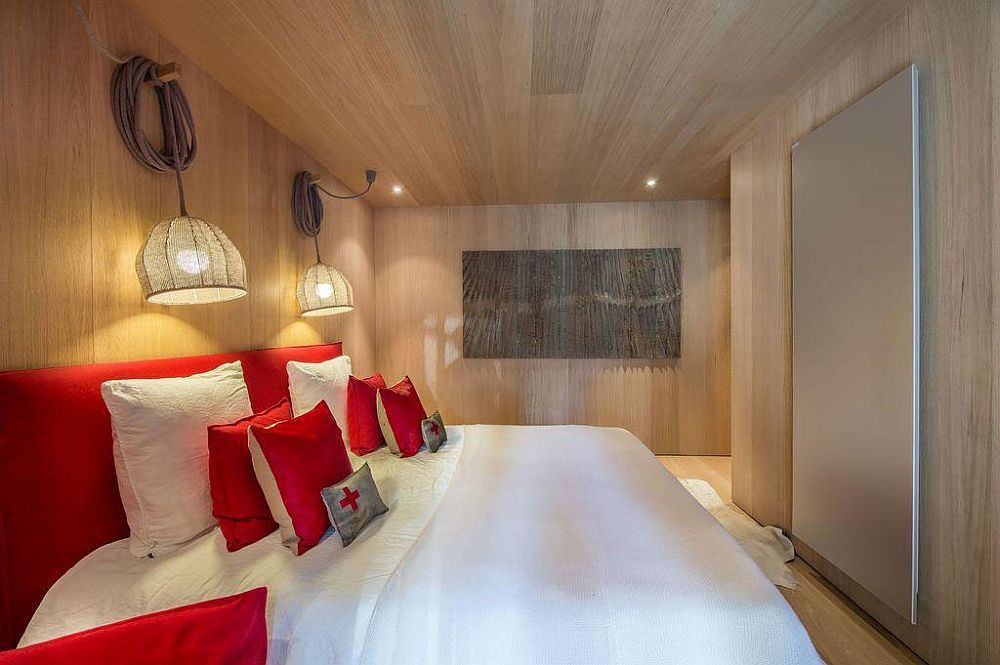 Pops of red enliven the chalet bedroom