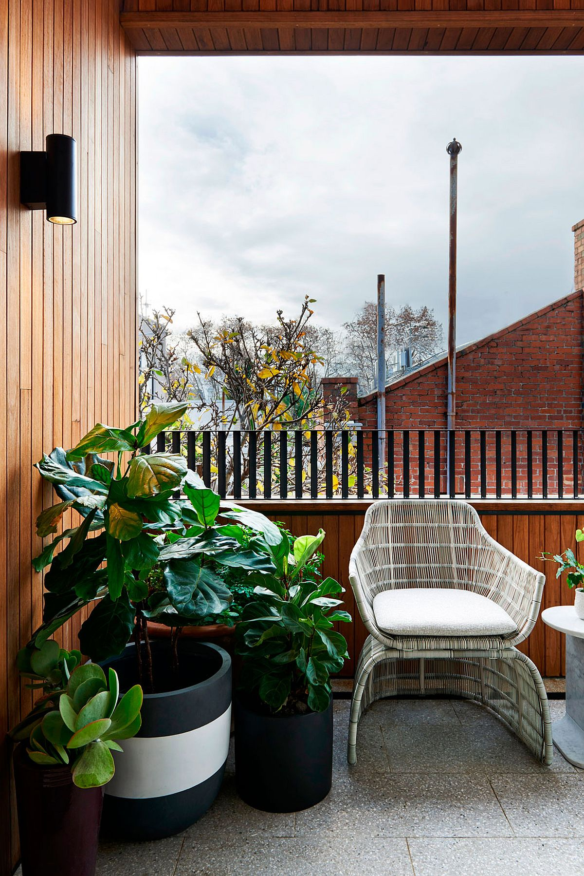Potted plants bring green goodness to the urbane Melbourne home