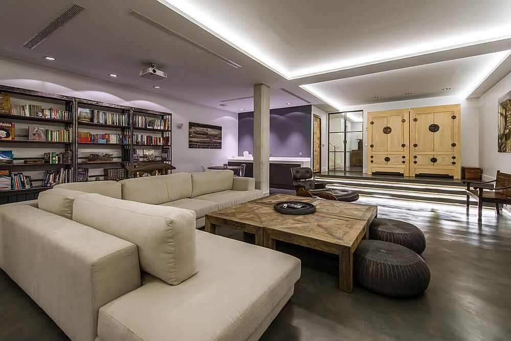 Purple wall brings color to the industrial living room
