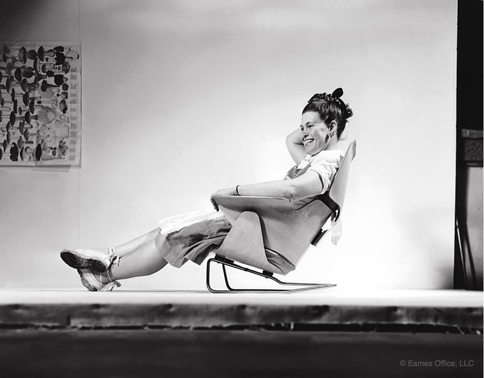 Ray Eames sitting on an experimental lounge chair in 1946. Image © 2016 Eames Office, LLC.