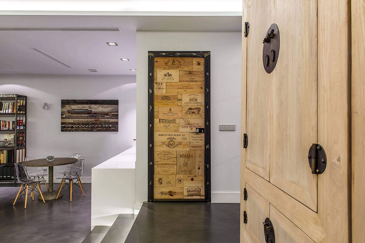 Reclaimed wood used to craft a unique door in the industrial setting