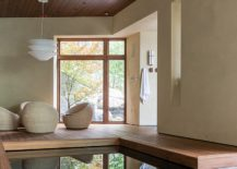 Relaxing-wooden-deck-of-the-modern-pool-house-217x155