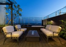 Rooftop-lounge-and-Jacuzzi-surrounded-by-lush-green-garden-217x155