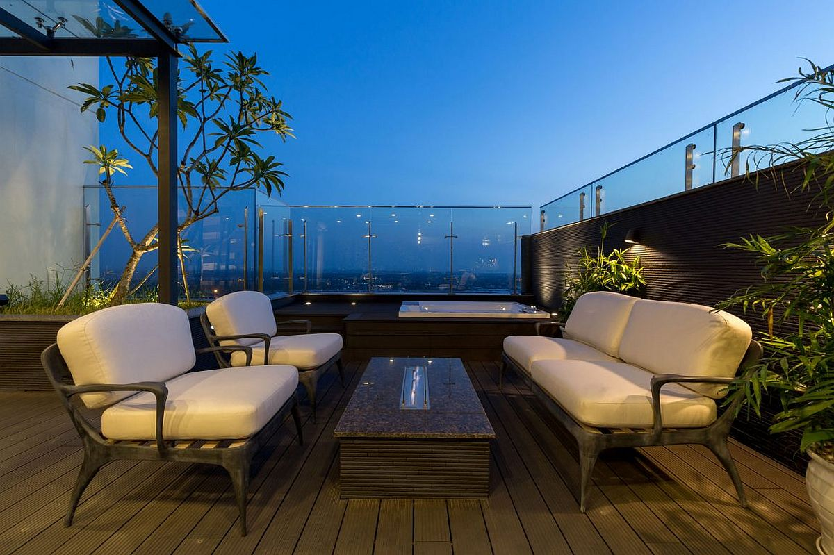Rooftop lounge and Jacuzzi surrounded by lush green garden