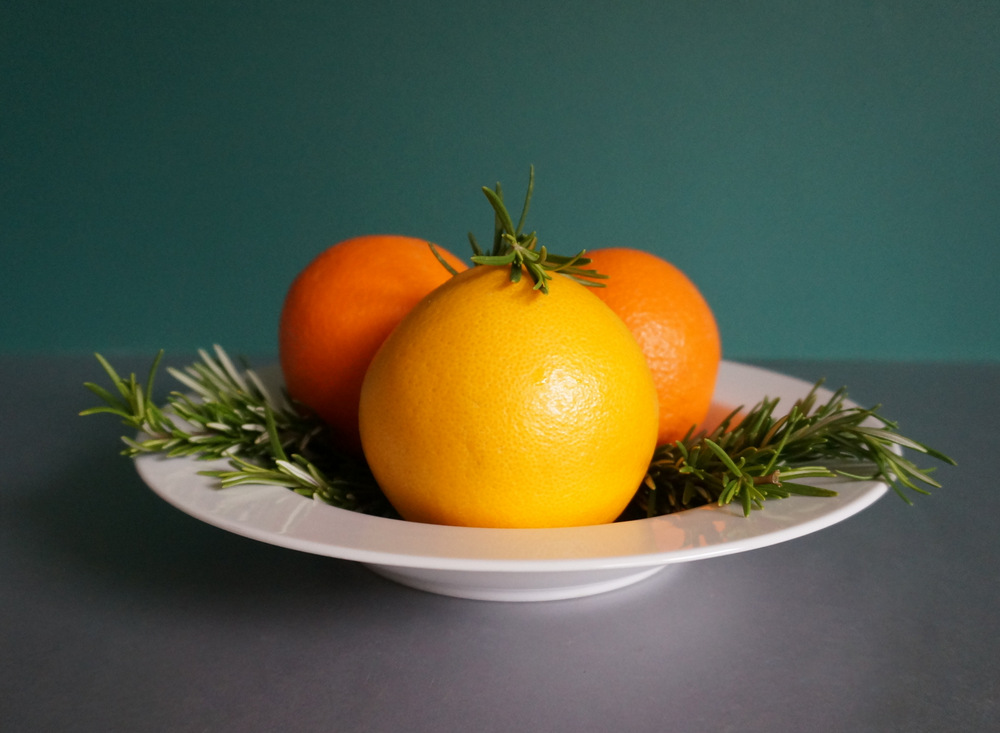 Rosemary and oranges make a lovely centerpiece