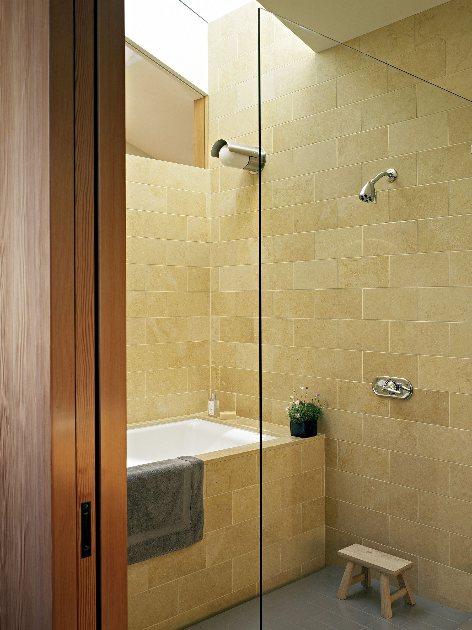 Skylight brings ample natural light into the modern bathroom