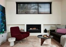 Sleek contemporary fireplace brings warmth to the small living room 217x155 Envisioned for an Urban Lifestyle: Timber Clad Y Residence in Prahran
