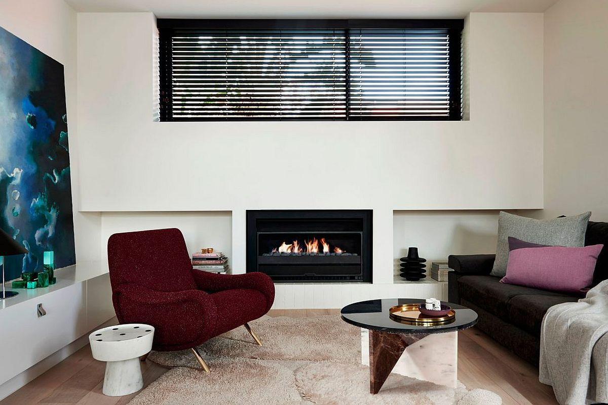 Sleek contemporary fireplace brings warmth to the small living room