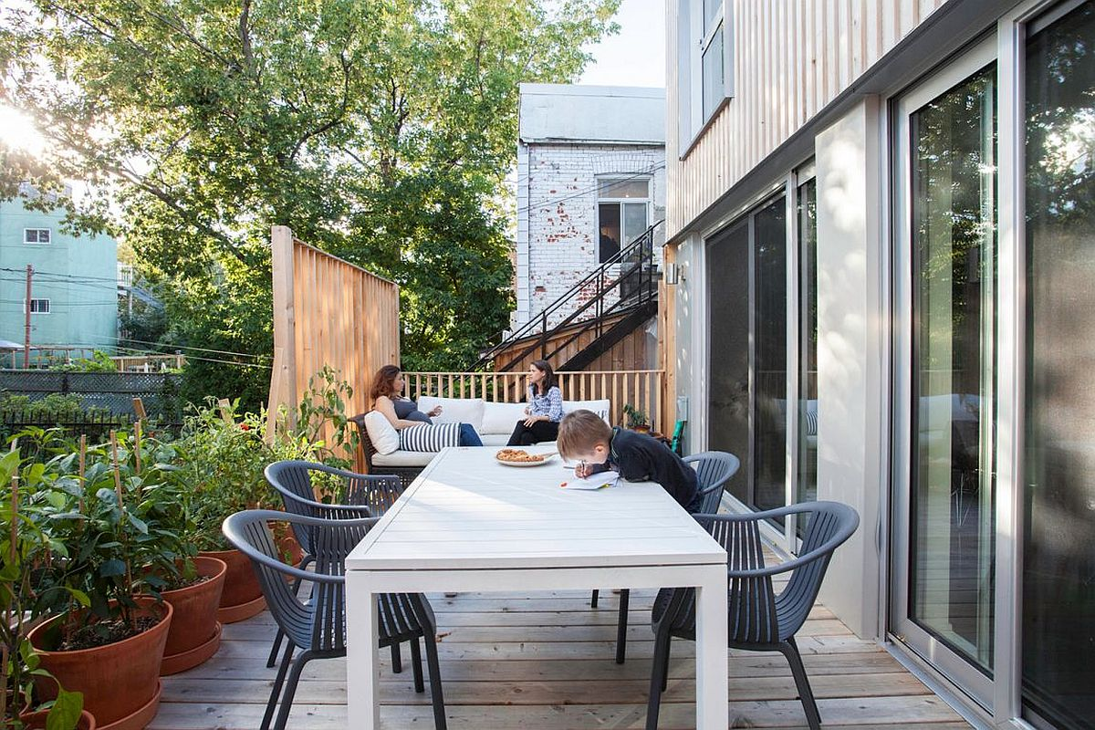 Small wooden deck with outdoor dining and a luxurious sofa
