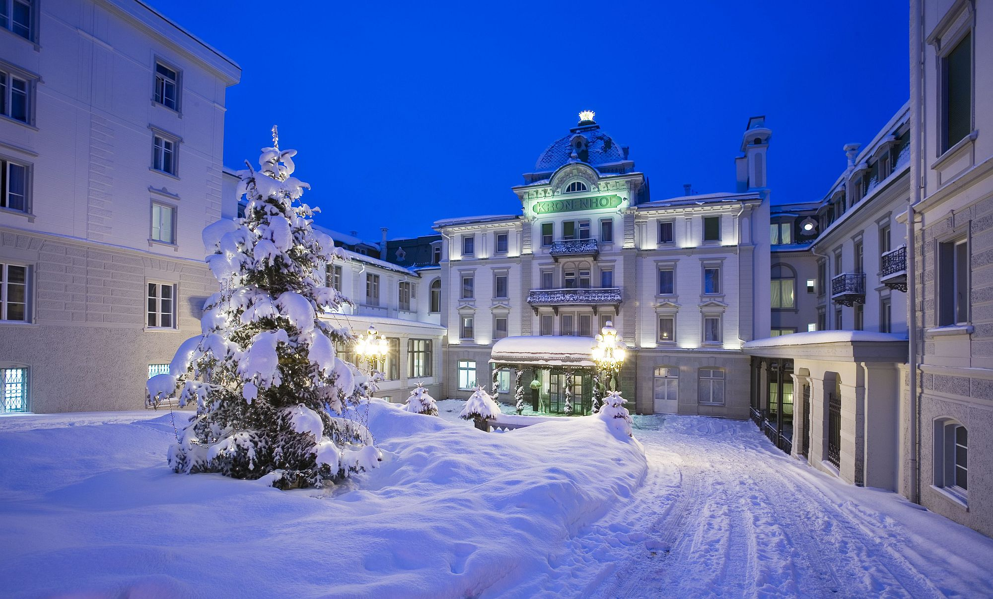 Snow covered entrance of Grand Hotel Kronenhof