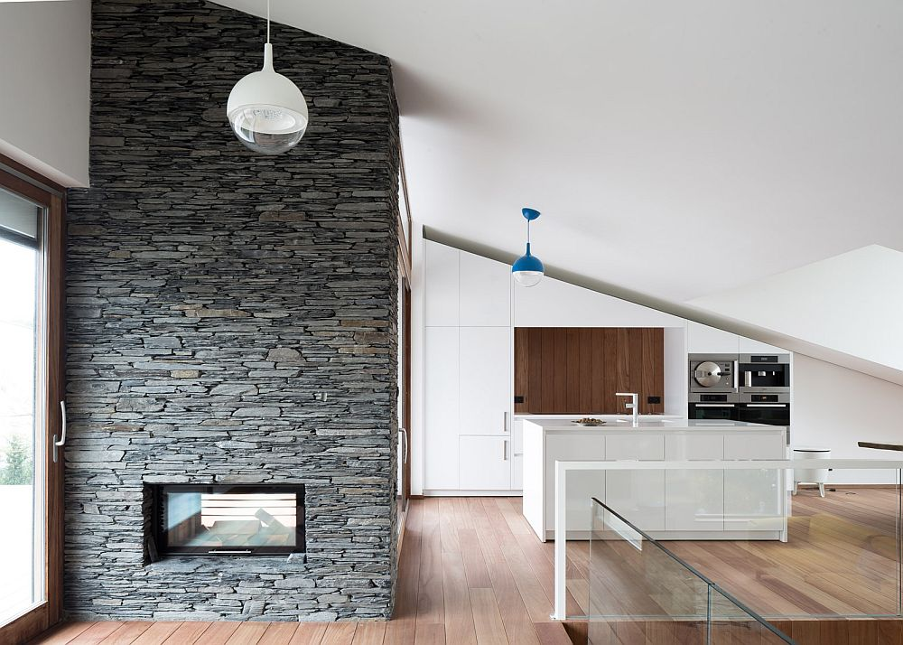 Stone fireplace inside contemporary House Pibo
