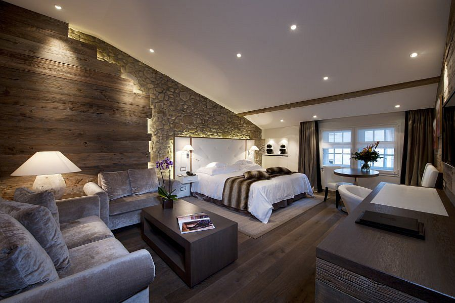 Stone walls bring old world charm to the luxurious hotel room