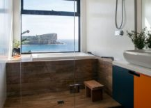Stunning-modern-bathroom-with-a-view-of-the-ocean-outside-the-window-217x155