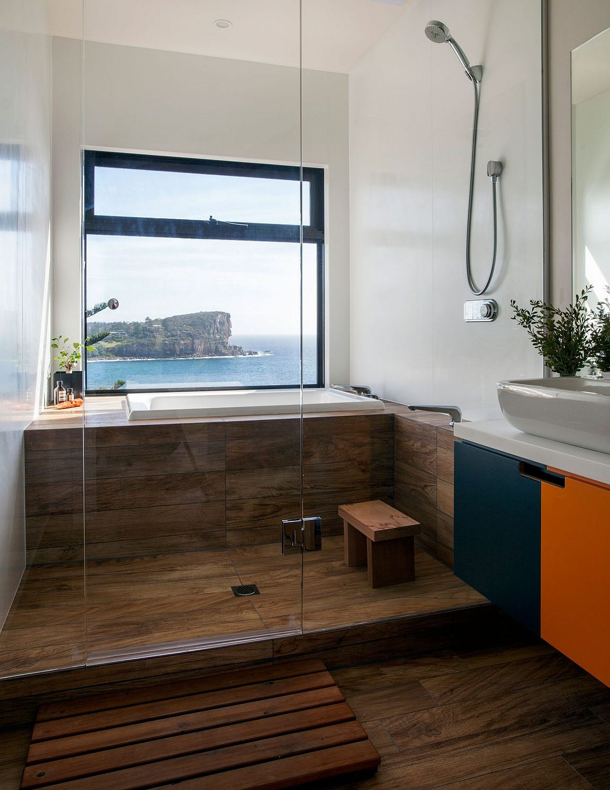 Stunning modern bathroom with a view of the ocean outside the window