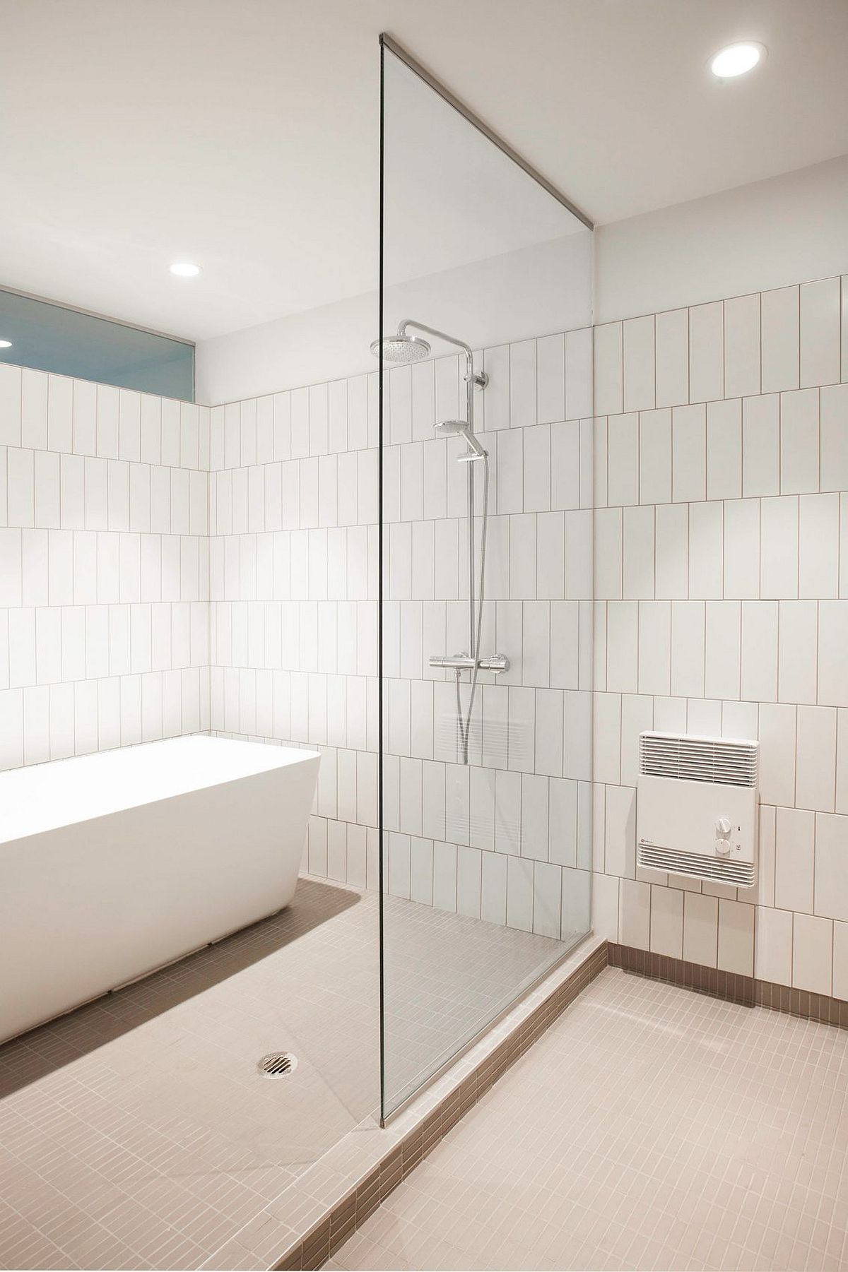 Stylish and simple modern bathroom design in white with thermal flooring