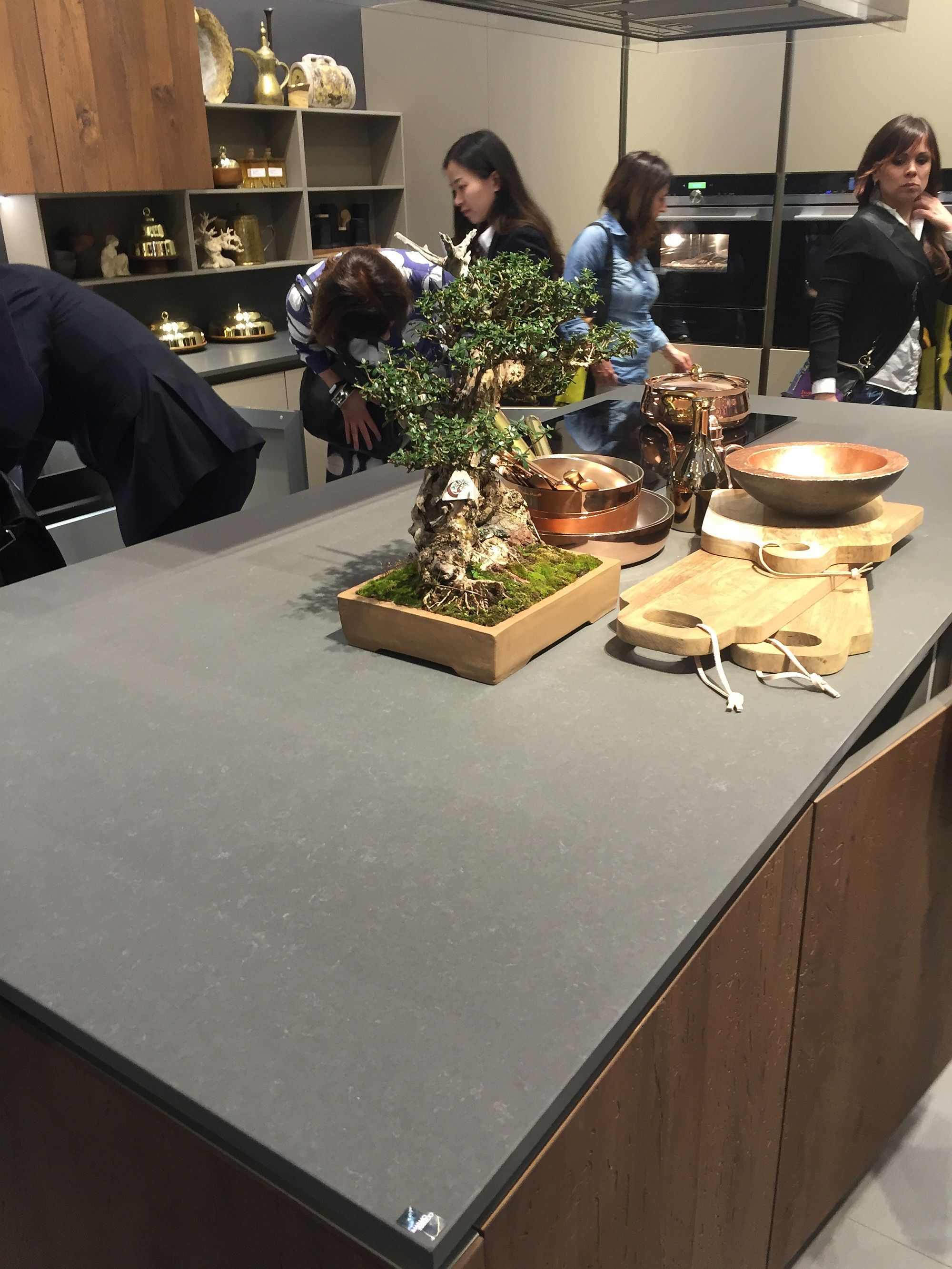 Stylish kitchen island with smart worktop and wooden cabinets