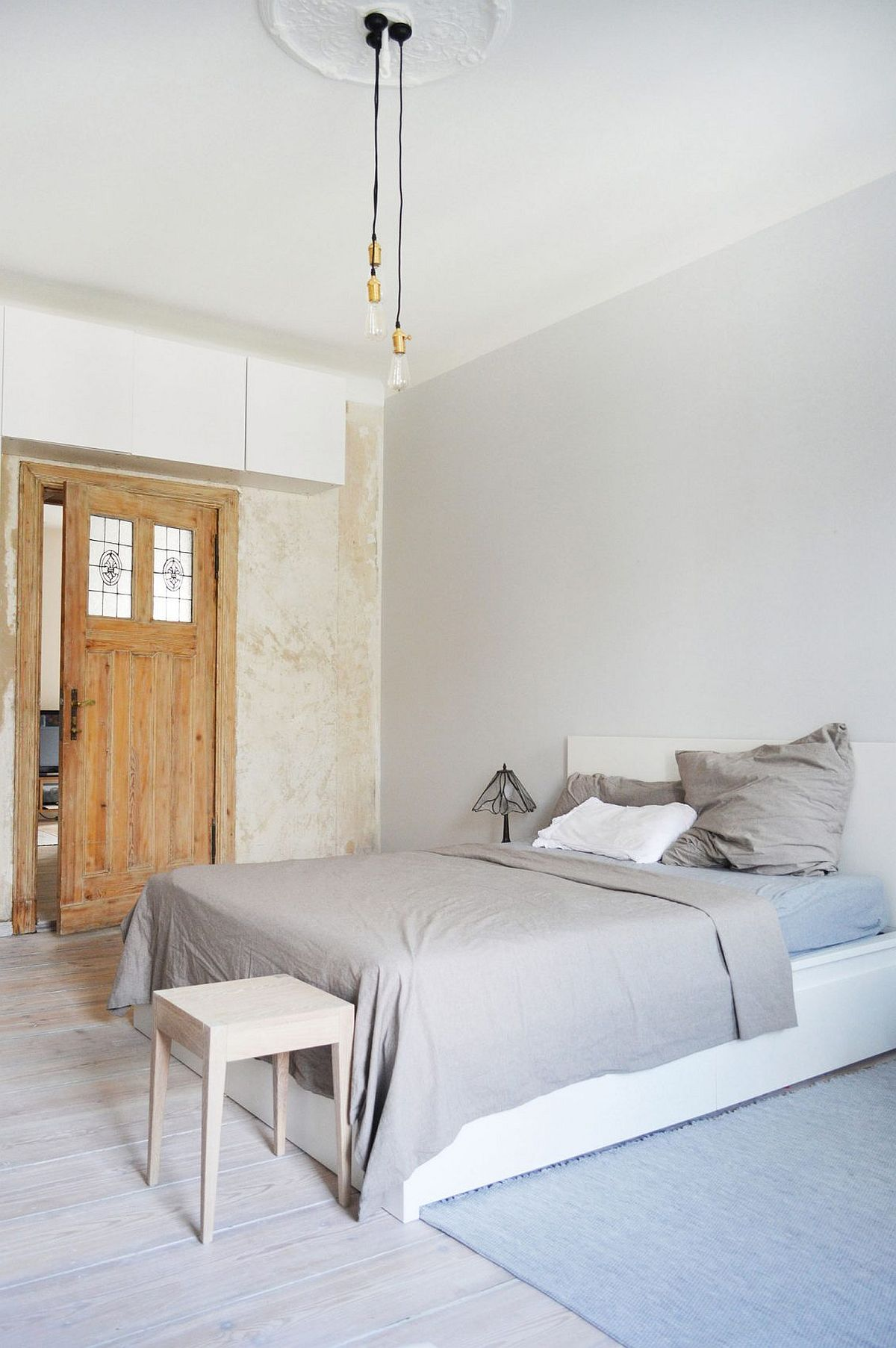 Textured walls give the bedroom a classic, modern look