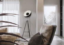Tripod-floor-lamp-in-the-corner-for-the-industrial-style-living-space-217x155