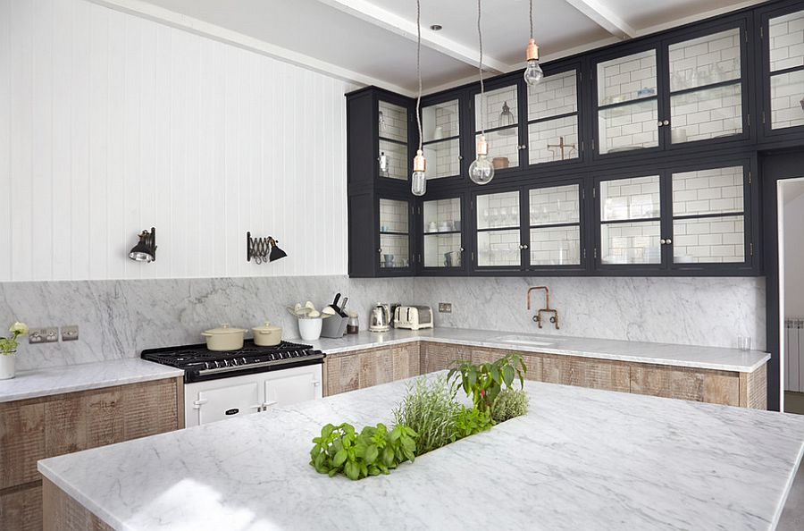 Unique kitchen island with marble top and a herb garden! [Design: Blakes London]