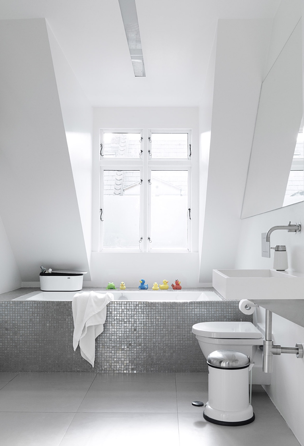 Vipp products bathroom, including the Vipp pedal bin and soap dispenser. Image © Vipp.