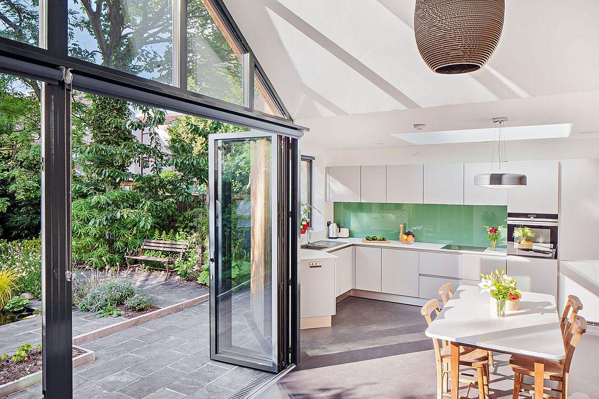 White modern kitchen with a green backsplash