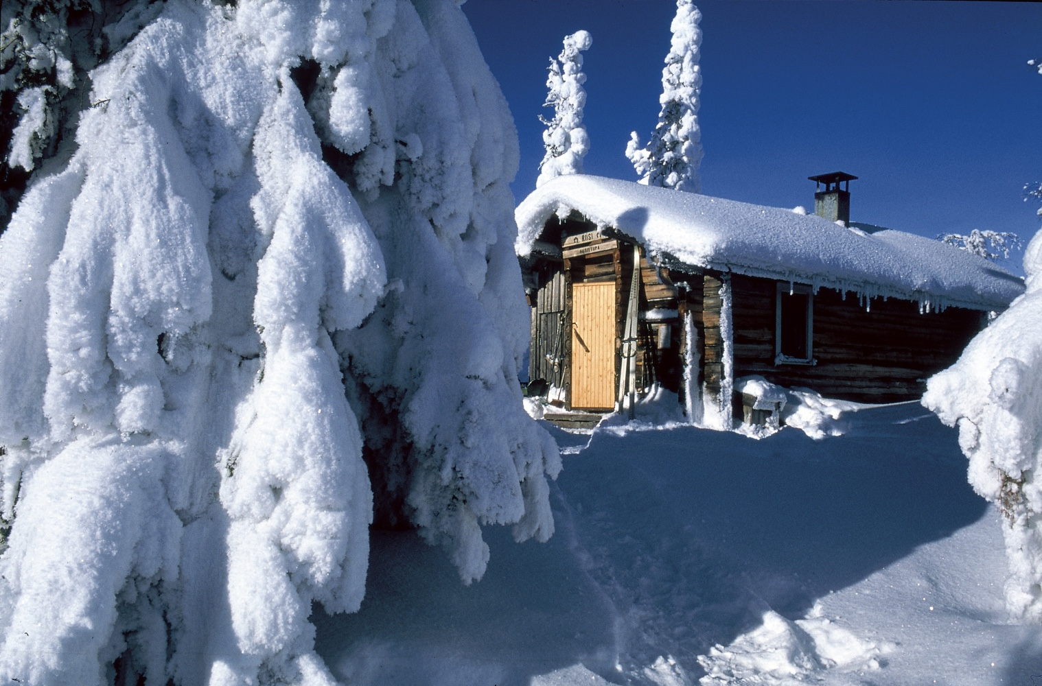 A cosy winter cottage in Finland. Image © Visit Finland.
