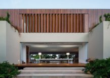 Wooden-slats-provide-privacy-and-ventilation-for-the-upper-level-of-the-contemporary-home-217x155
