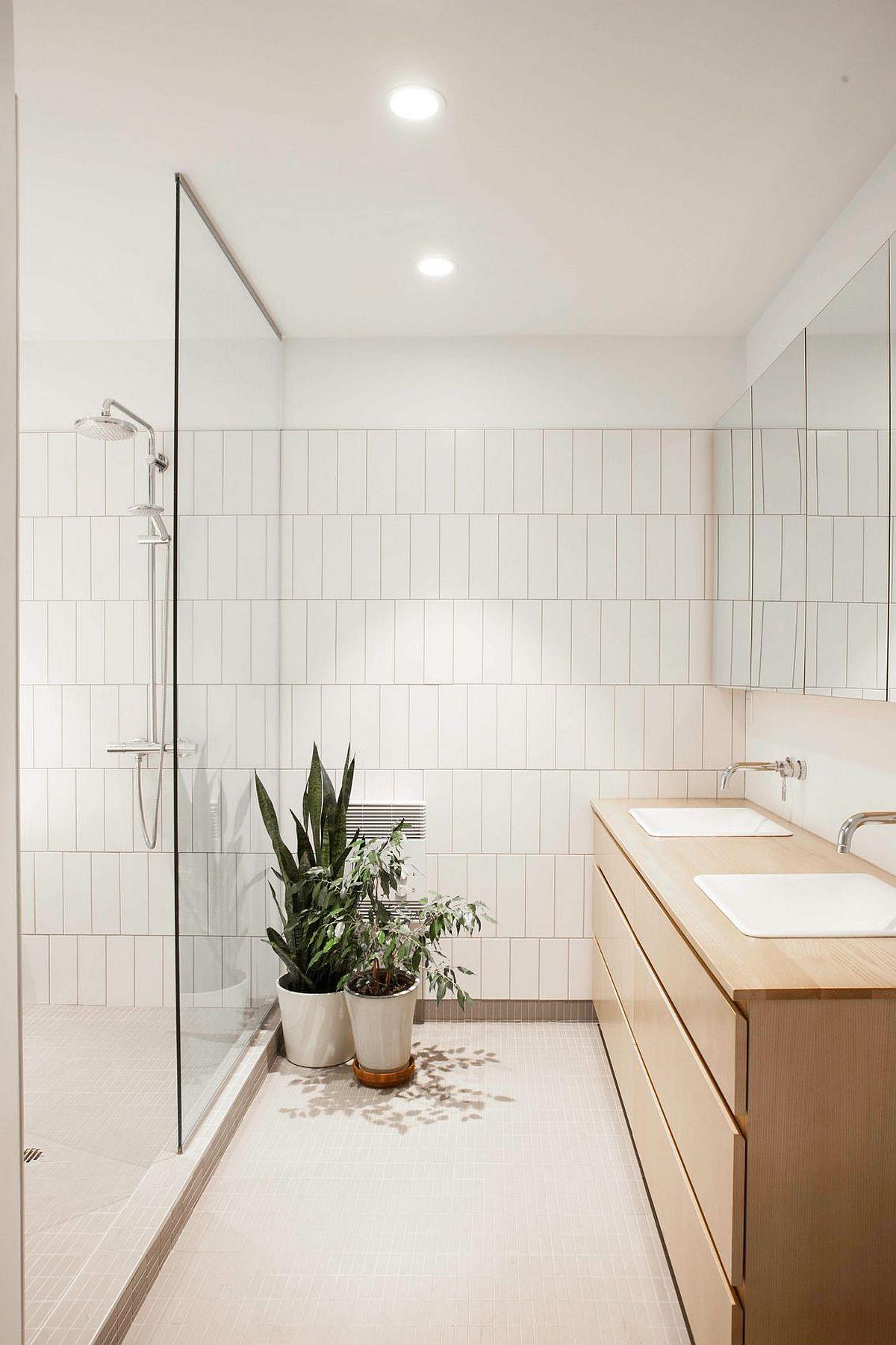 Wooden vanity for the light-filled bathroom in white