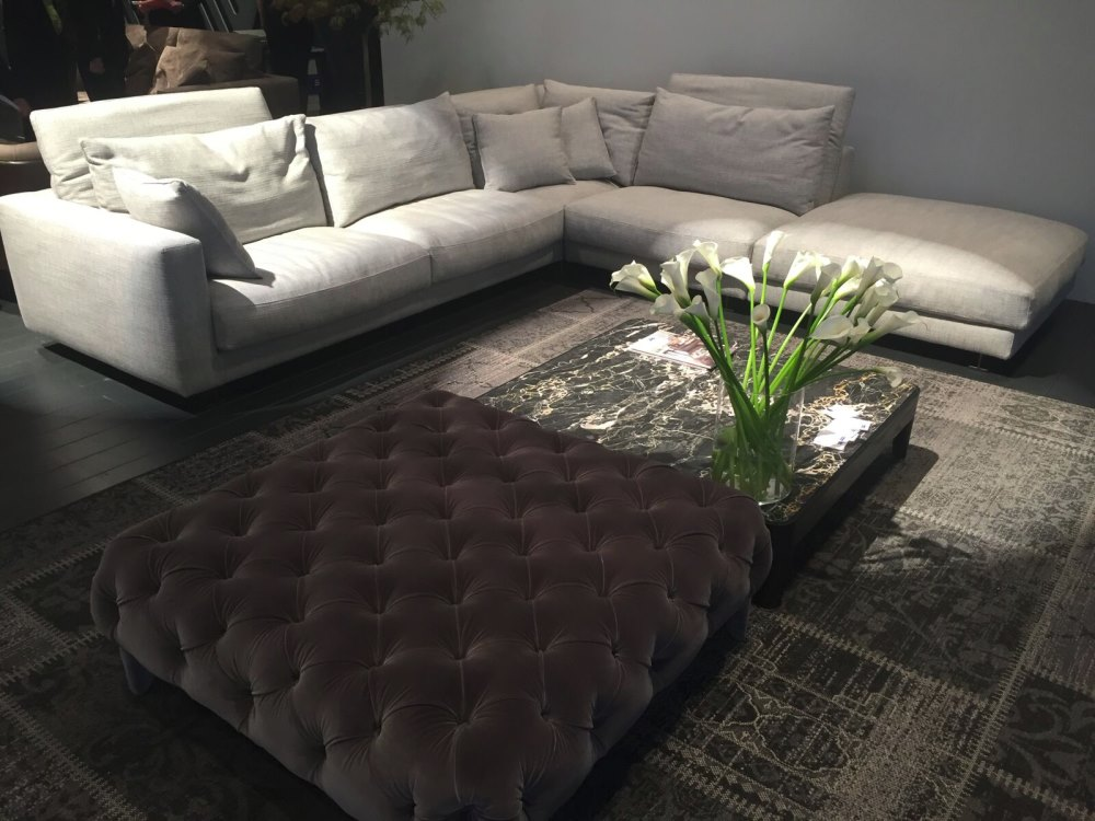 A modern sofa with matching throw pillows