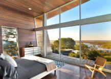 Bedroom-with-sliding-glass-doors-maximizes-view-of-the-beachy-landscape-217x155