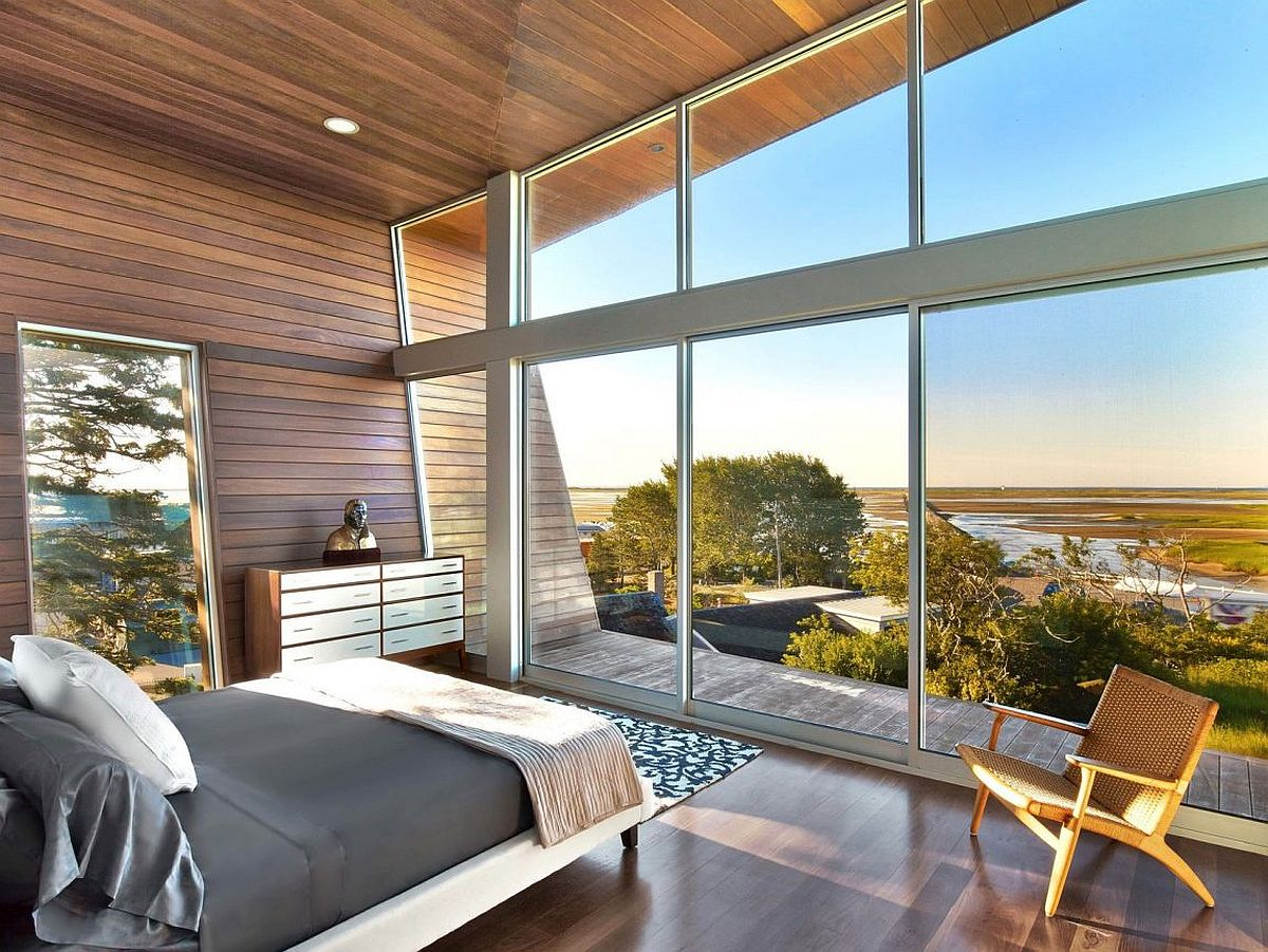 Bedroom with sliding glass doors maximizes view of the beachy landscape