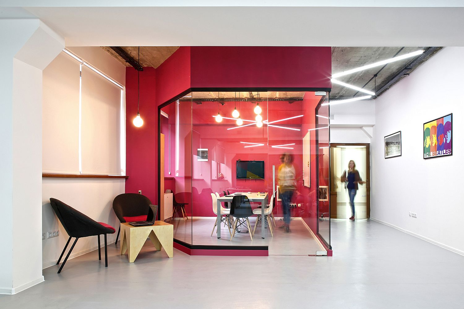 Bright and bold pink creates a vivacious conference room for the modern office