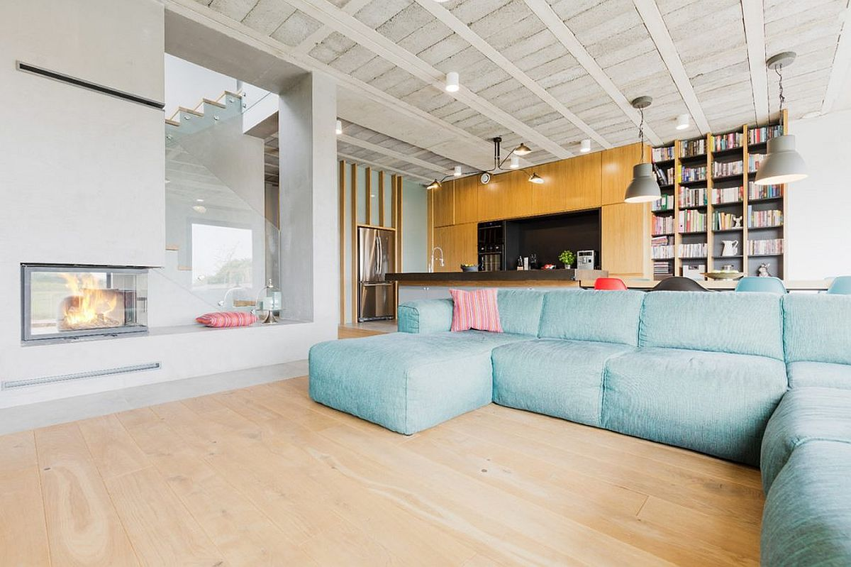 Raw Minimalism Laced with Splashes of Color: House in Sierosław