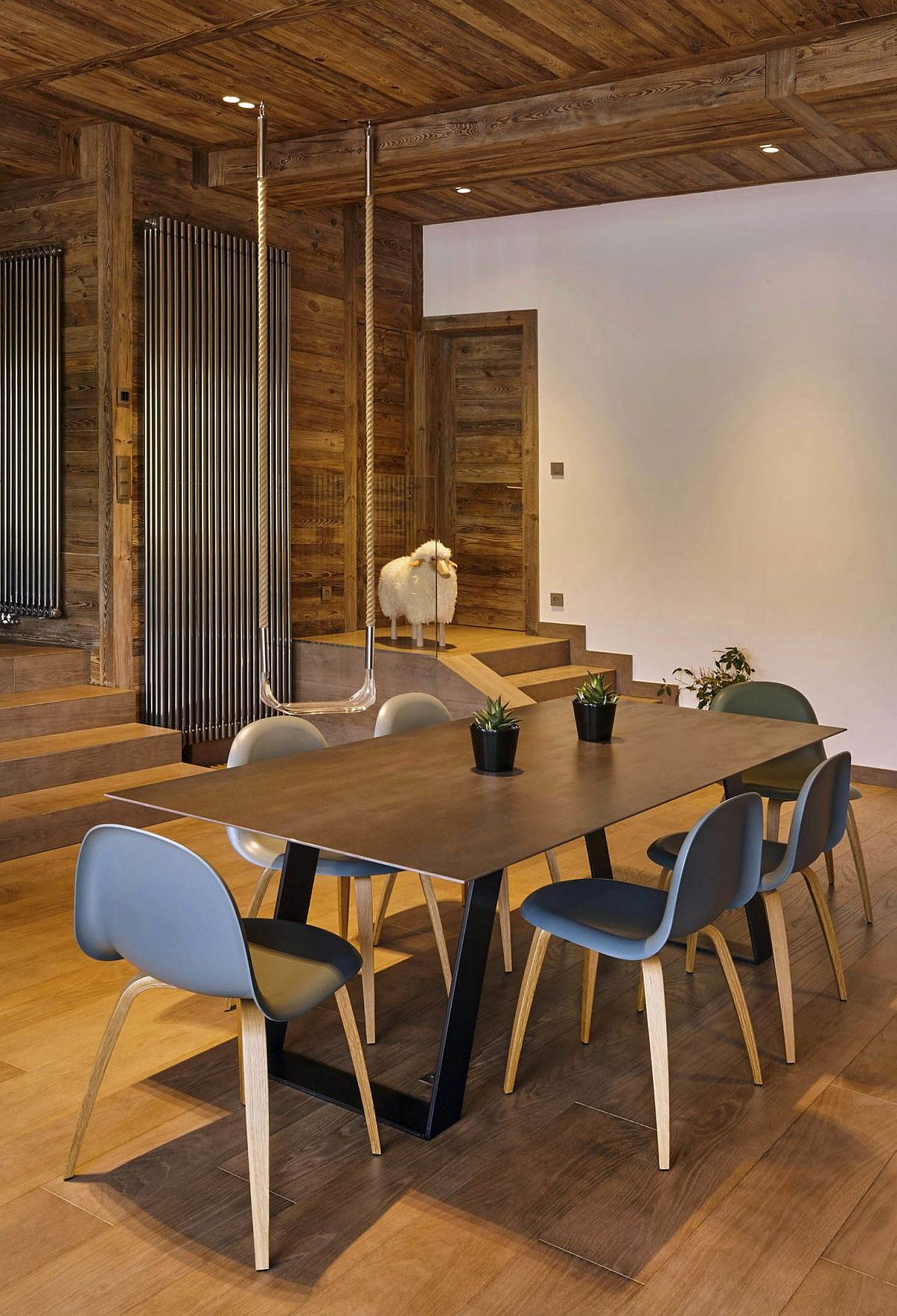 Ceiling clad in wood adds beauty to the dining room