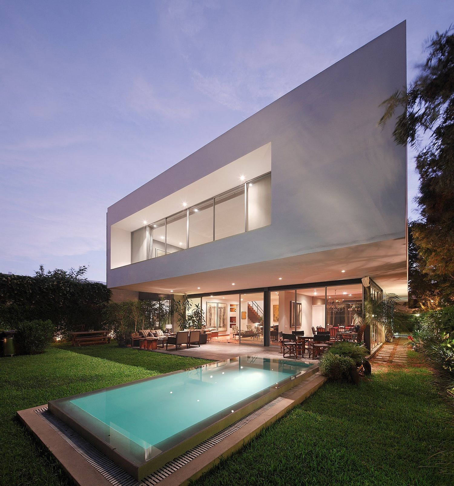 Contemporary House M in Lima with a relaxing pool in the backyard