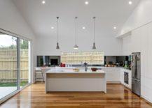 Contemporary-kitchen-in-white-with-a-dark-backsplash-217x155