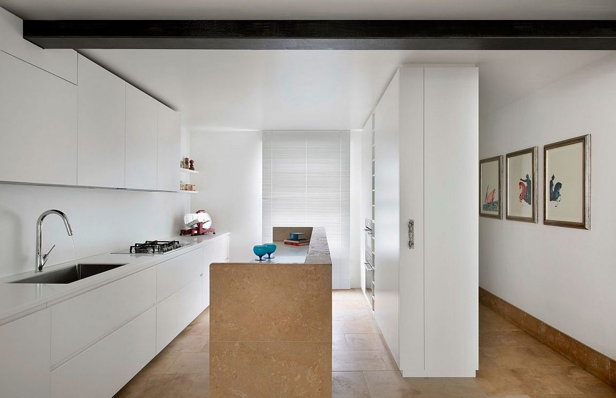 Contemporary kitchen in white with a smart island