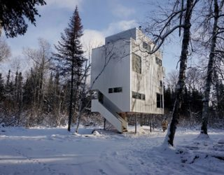 Pole House: an Idyllic Winter Escape That Stands on Recycled Gas Pipes