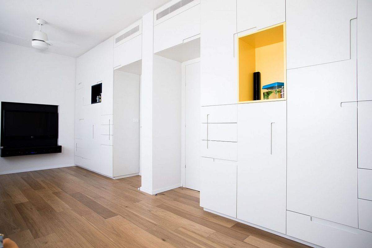 Custom units and built-in cabinets give the kids' room a minimal look