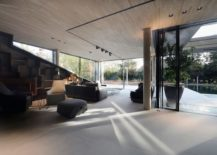 Dark-backdrop-of-the-staircase-adds-to-the-appeal-of-the-living-area-217x155